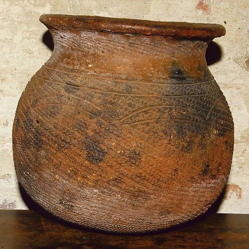 A Nupe clay pot with geometric design. Nigeria.