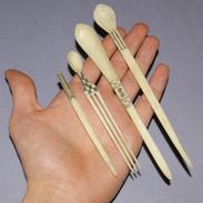 Three Zulu bone snuff spoons.