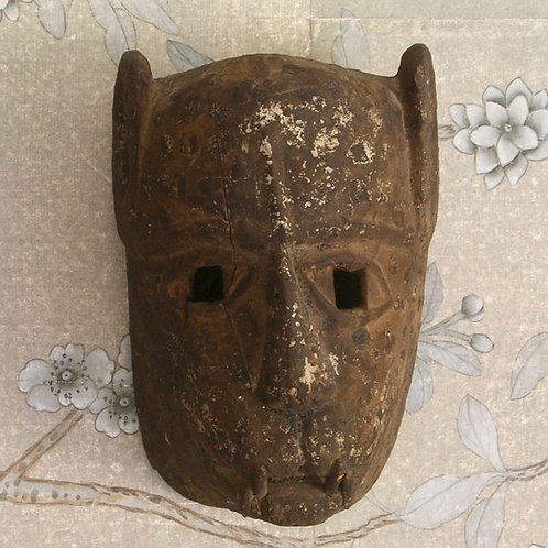 A leopard mask. Early 20th C. Possibly Tanzanian.