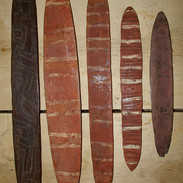 Aboriginal churingas and bullroarers.