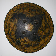 A 19th C Rajhistan painted and lacquered shield.