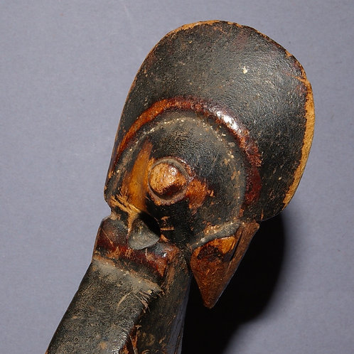 A Senufo heddle pulley in the form of a bird. Early-mid 20th C.