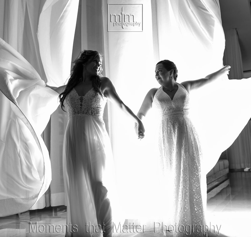 Black and white brides with amazing curtain back light!
