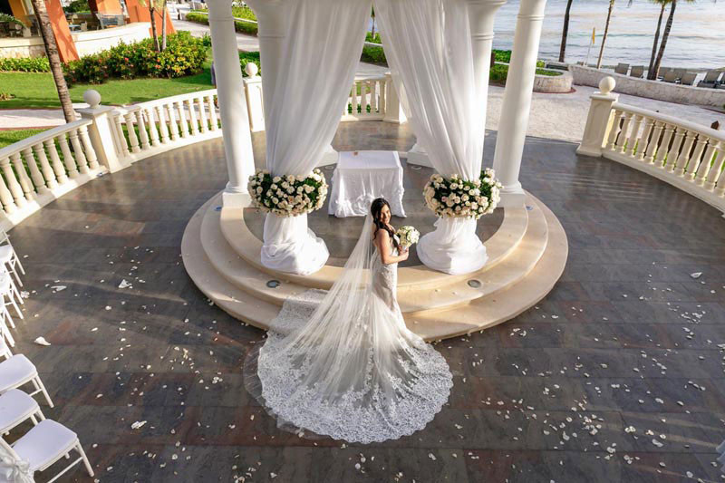 Bride full weddings dress at gazebo