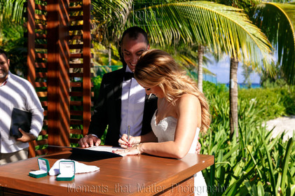 Bride and groom signing the wedding documents