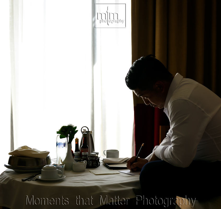 Writing his wedding vows