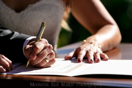 Signing the wedding documents