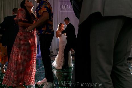 Bride and groom reception hall party