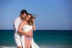 Pregnant couple on the beach