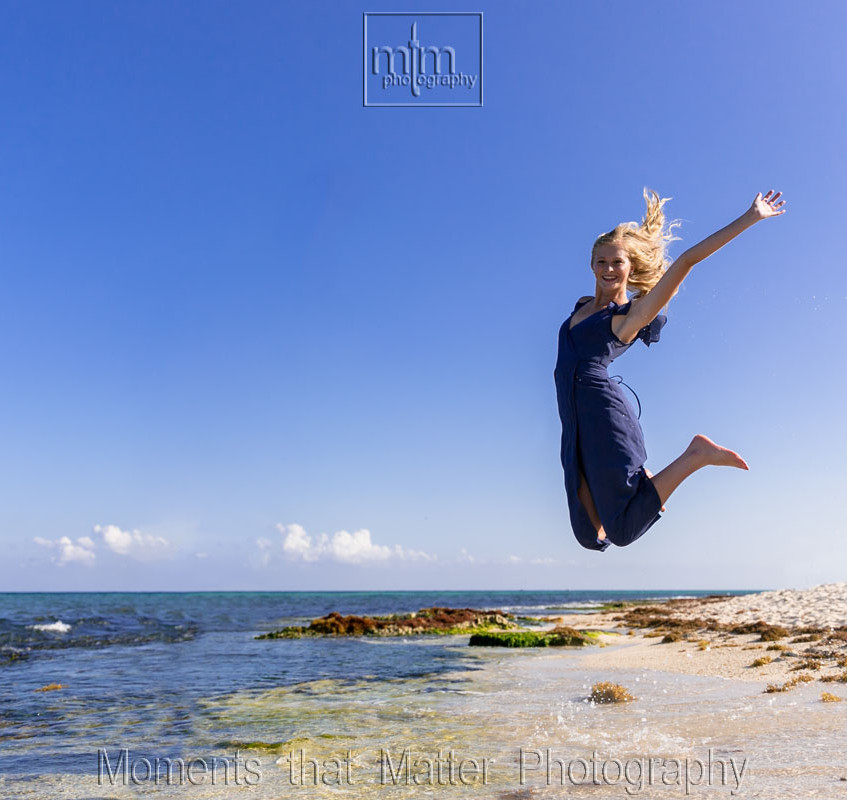 Seniors photo girl jumping on beach