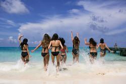 girls running to the ocean