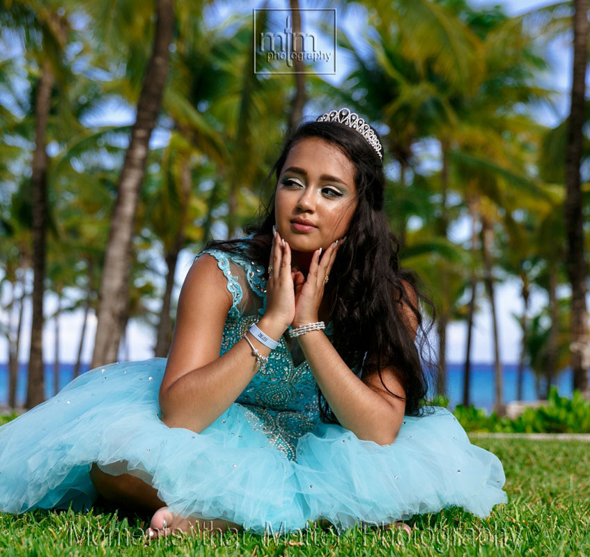 Girl sitting in Quinceanera dress