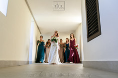 Bride and bridesmaids walking to the ceremony at Unico