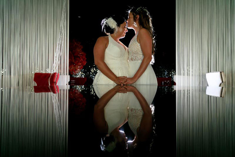 Bride and bride reflection over piano
