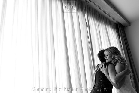 Mother and daughter hug before the cermony