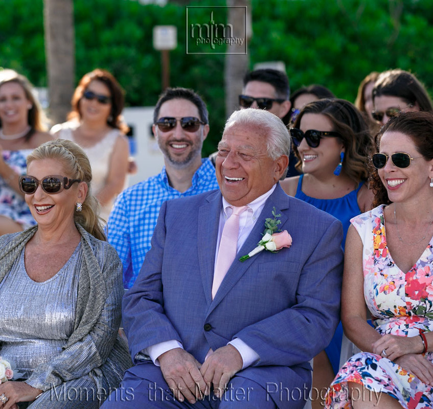 Happy parents watching their daughter get married
