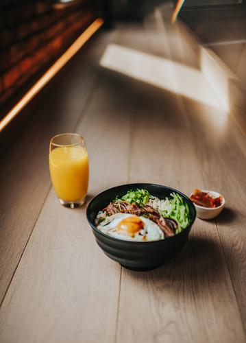grilled duck donburi and orange juice.jp