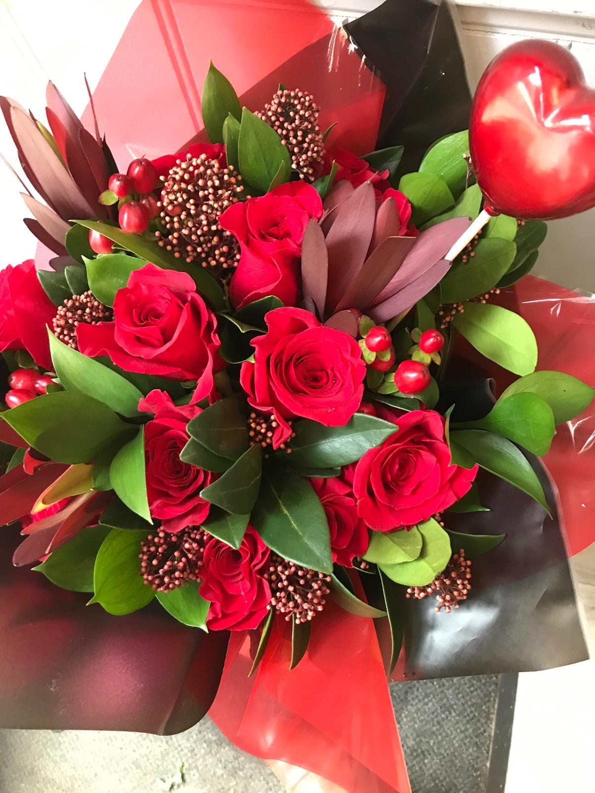 A Dozen Red Roses in aqua pack