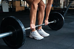 man with barbell weight on floor.jpg