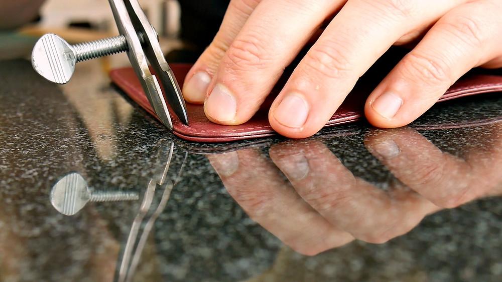 Adjustable leather edge creaser