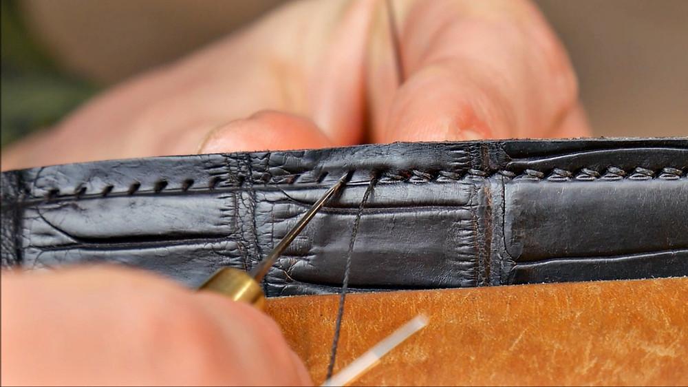 hand stitching alligator skin