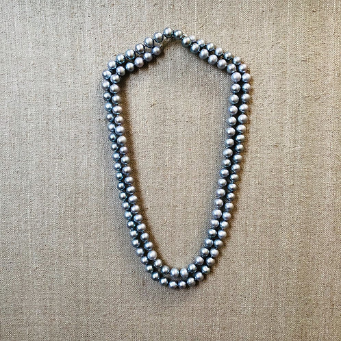 Long silver pearl rope necklace