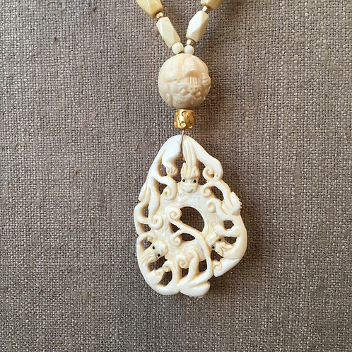 Bone with carved pendant necklace