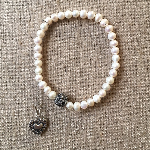 Pearls with heart charm