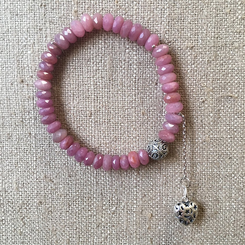 Ruby bracelet with heart charm