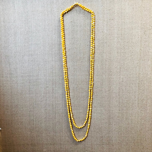 Golden pearl rope necklace