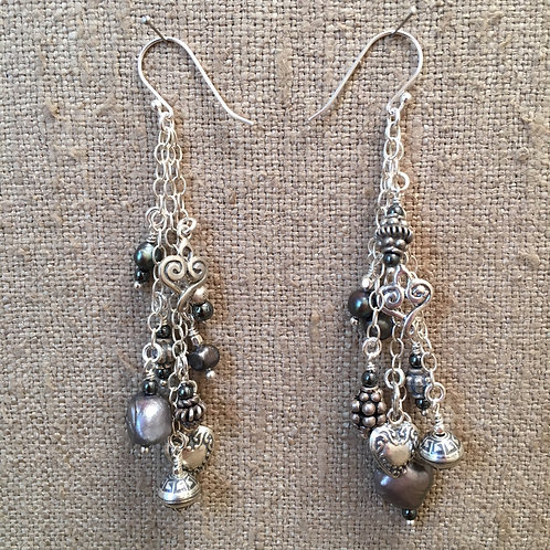 Sterling silver with pearls and charms