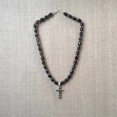 Faceted smoky quartz with cross