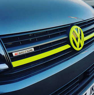 VW campervan T6 4 motion with lime green badge and grille