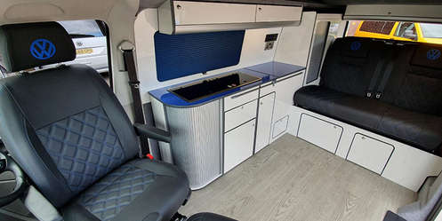 Blue and white interior with black leather RIB bed and seats