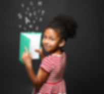African-American little girl with book and alphabet letters on dark background.jpg