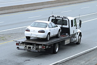 Repossessed vehicle on a tow truck