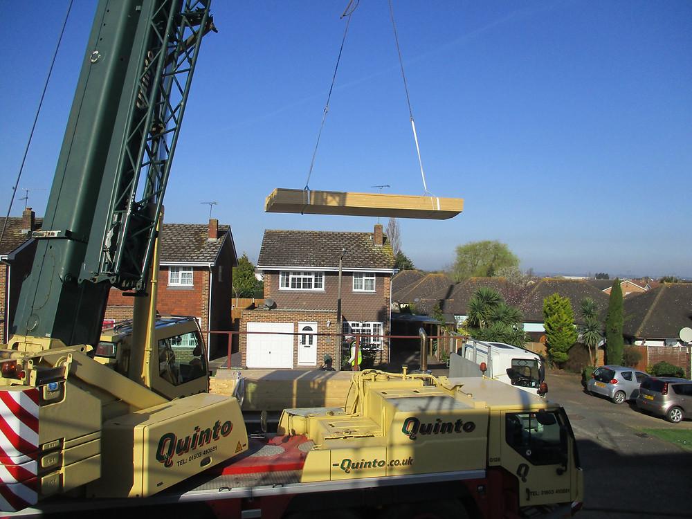 Crane lifting timber