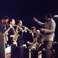 """Thad Jones directs the saxophone section (L to R: Joe Henderson, Jerry Dodgion, Jerome Richardson, Eddie Daniels, & Pepper Adams) during the """"Groove Merchant""""soli in Denmark, September 1969"""