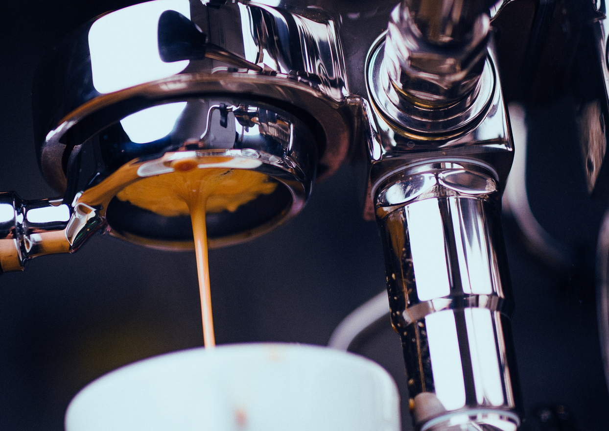 espresso-machine-extracting-coffee-and-d