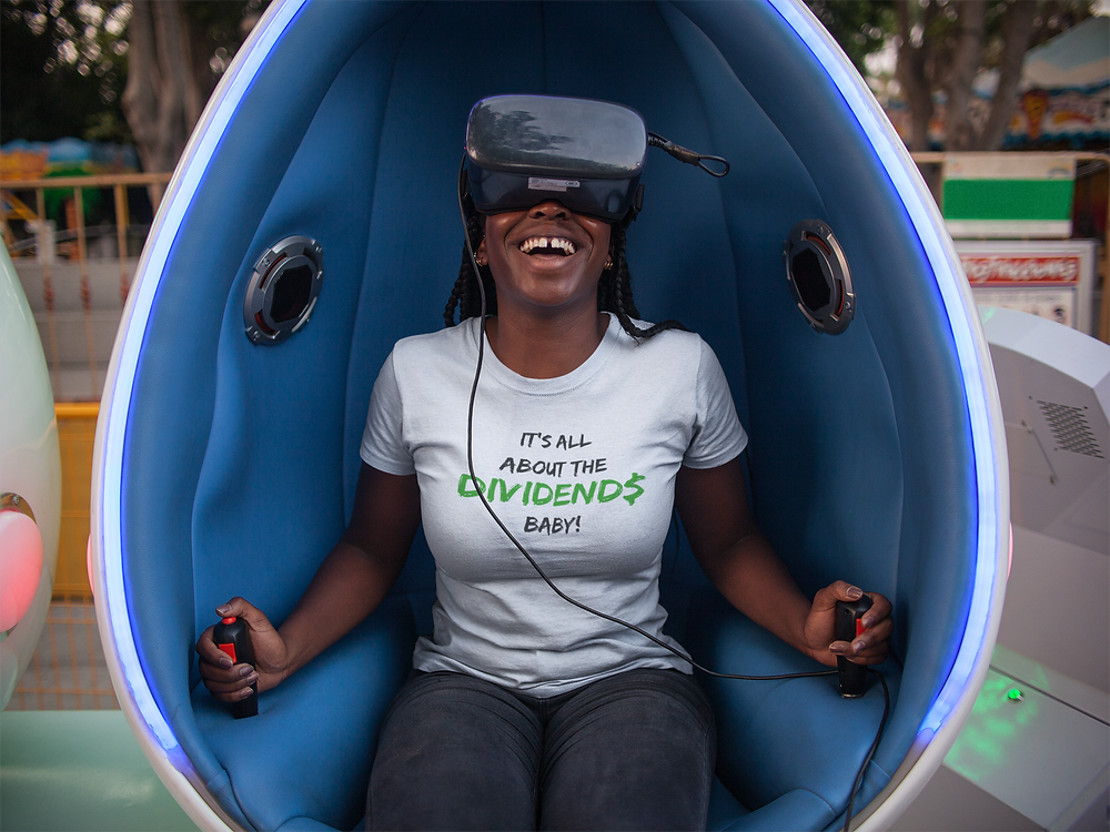 Black woman in Dividends t-shirt with a VR headset on