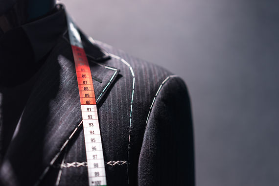 Mannequin with basted jacket by a tailor