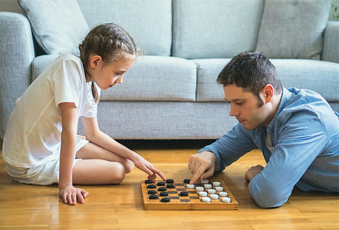 Father%20and%20daughter%20playing%20checkers%20board%20game._edited.jpg