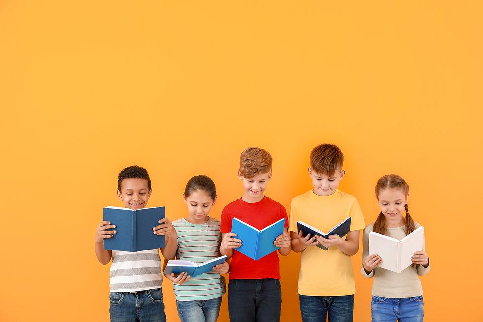 Cute little children reading books on co