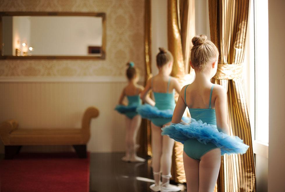 Beautiful little ballerinas in blue ball