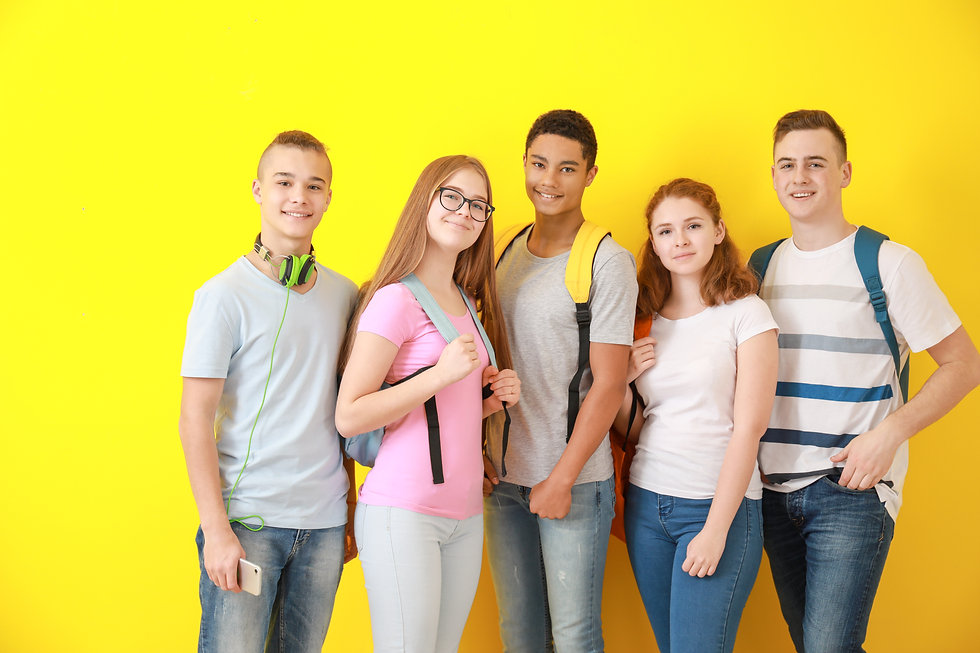 Group of teenagers on color background.j