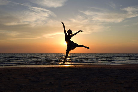 Ballet dancer's silhouette by the Sea in