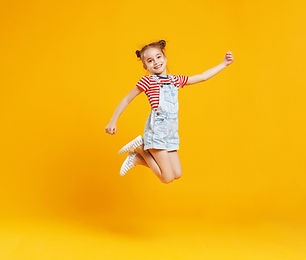 funny%20child%20girl%20jumping%20on%20a%