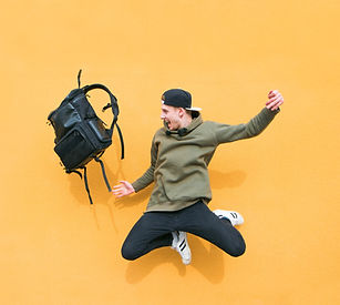 Street%252520young%252520man%252520jumping%252520with%252520a%252520backpack%252520on%252520the%2525