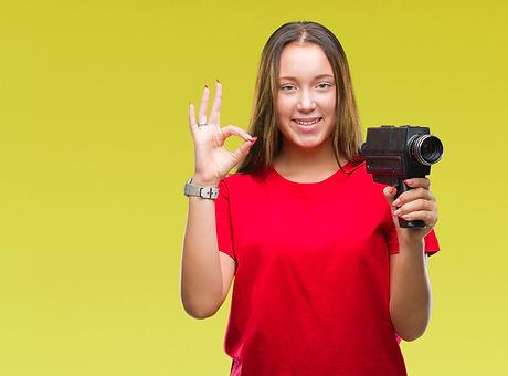 Young beautiful caucasian woman filming