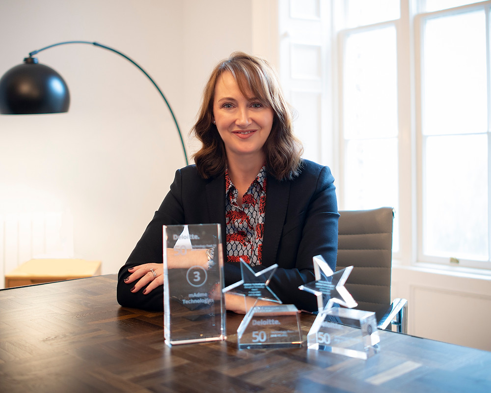 Triona Mullane, CEO, mAdme Technologies pictures with 3 awards won by mAdme at Deloitte Technology Fast 50